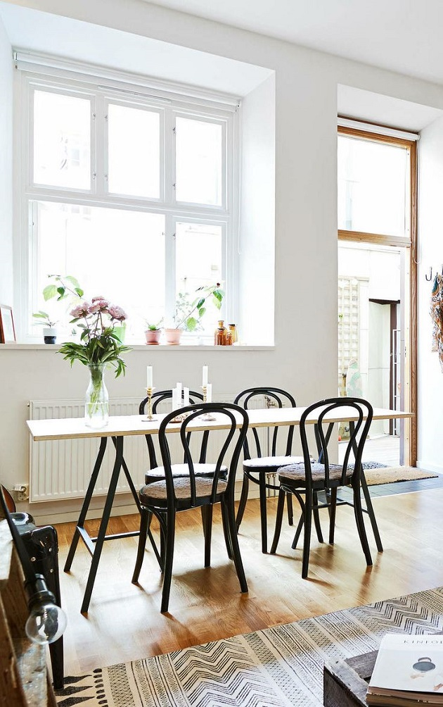 Bentwood chairs in bright dining room
