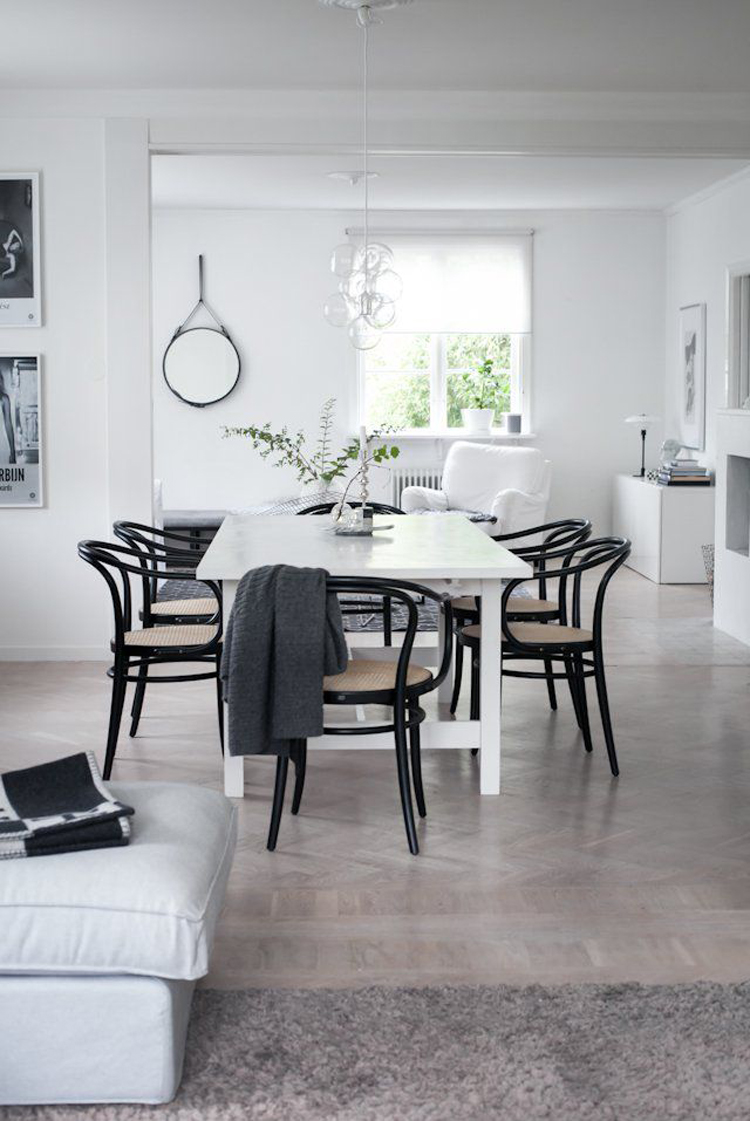 black bentwood chairs around white dining table via house of philia