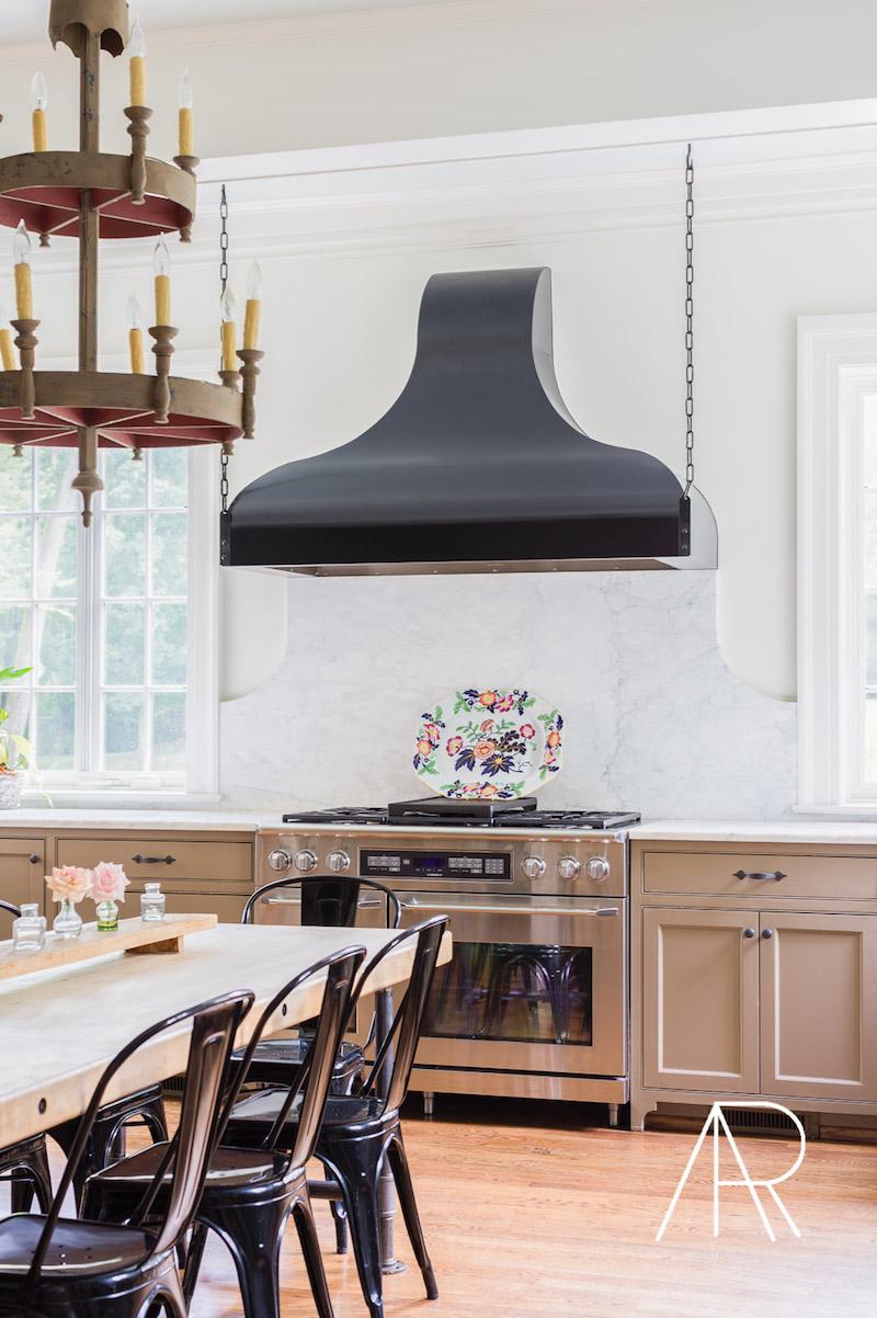 Black tolix chairs in modern dining room via Alyssa Rosenheck