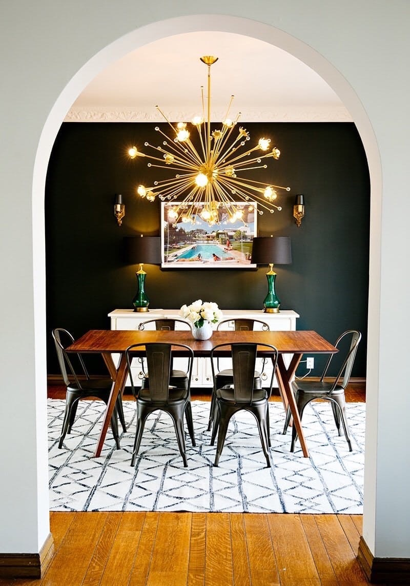 Black wall dining room with gold sputnik chandelier