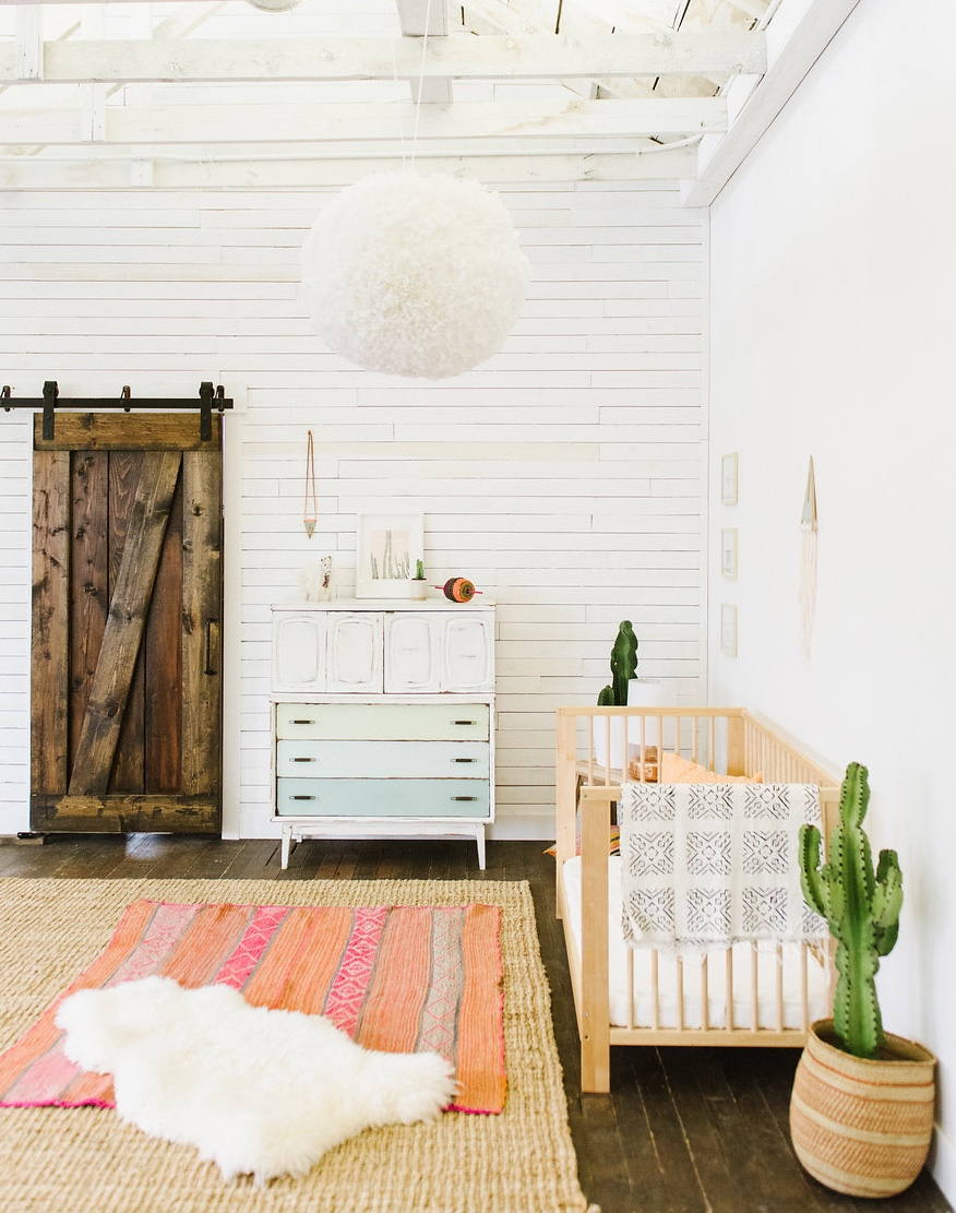 Bohemian baby nursery with cactus