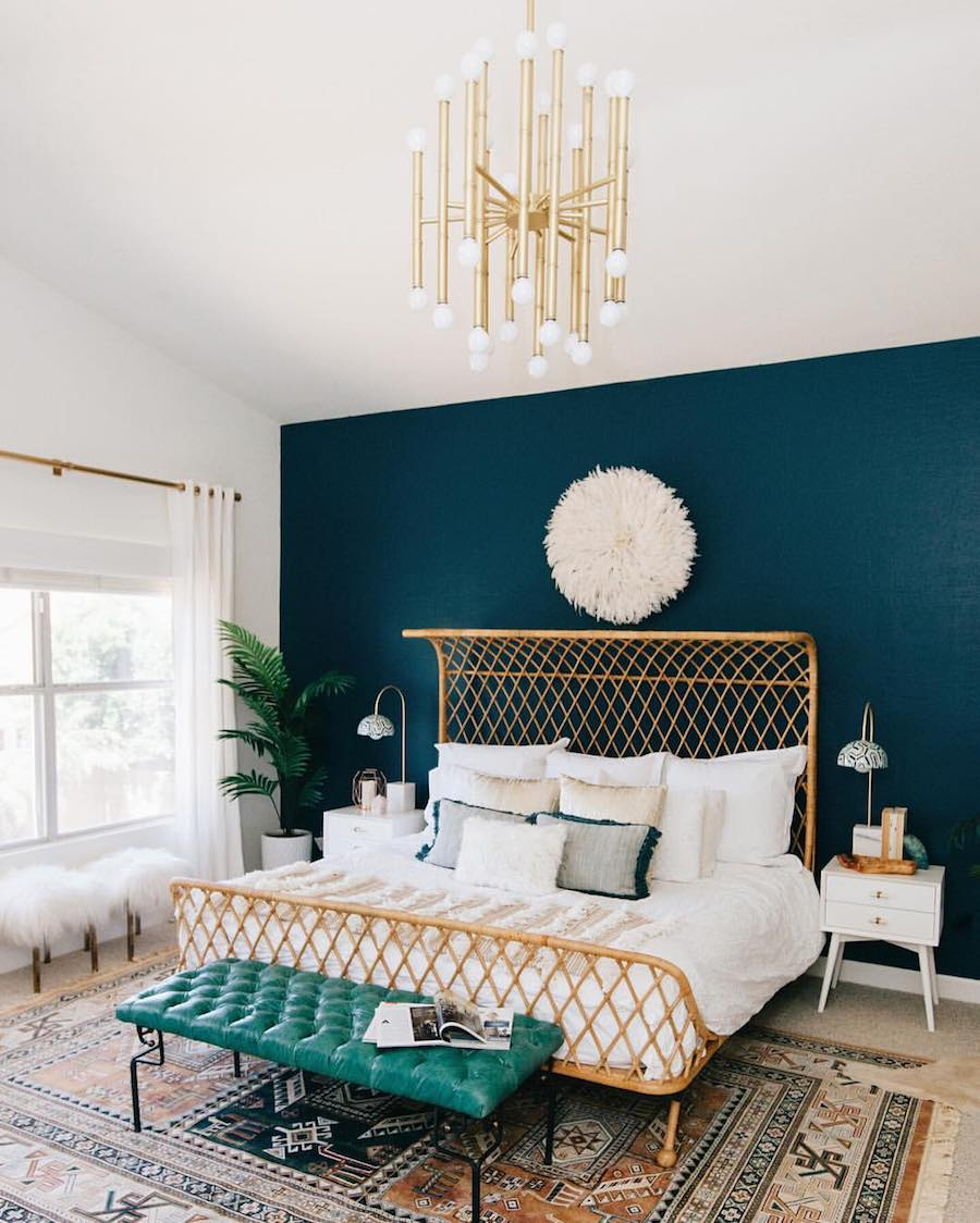 Bold teal accent wall in the bedroom
