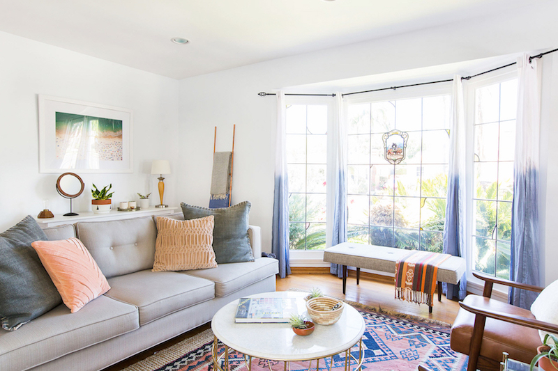 Bright living room with half-tone curtains