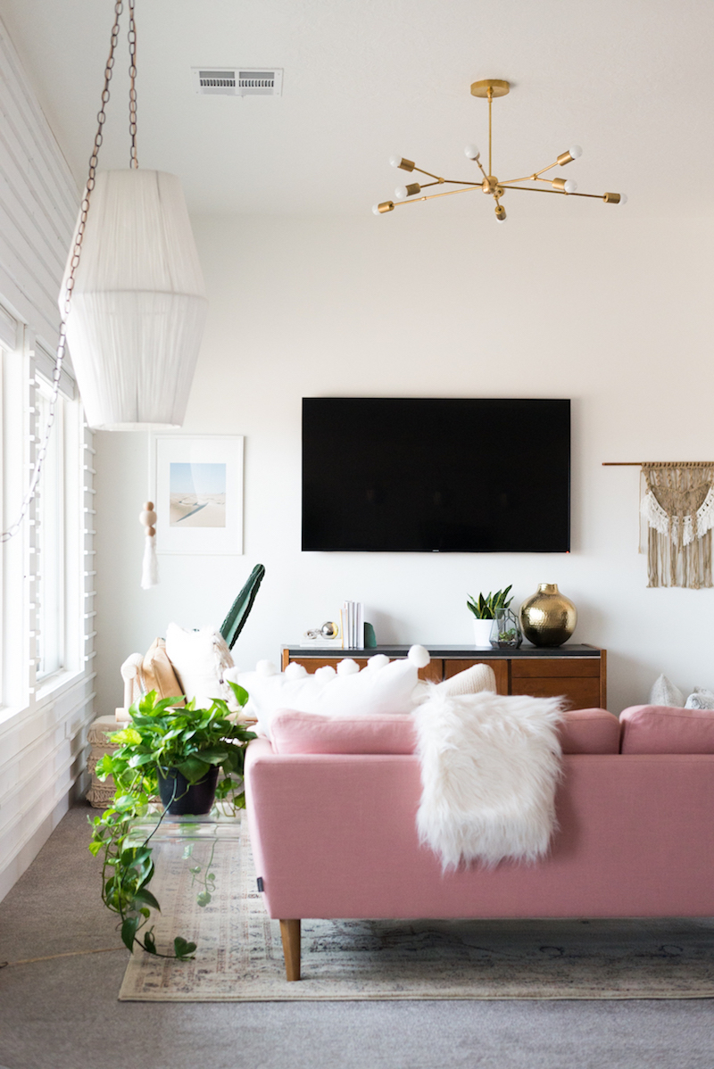 Bright pink sofa in white living room