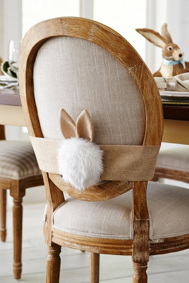 Bunny tail decor on back of dining chair