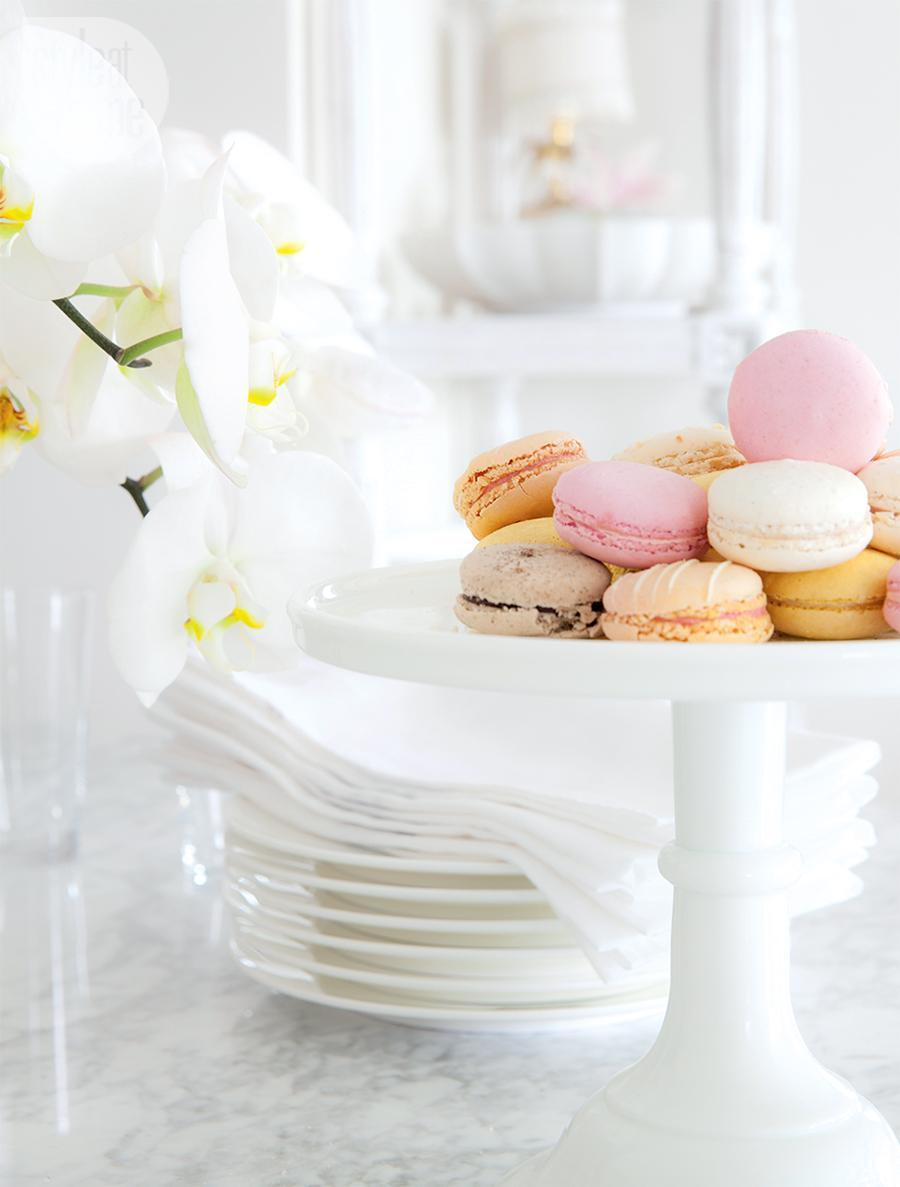 Colored macarons on white marble countertop