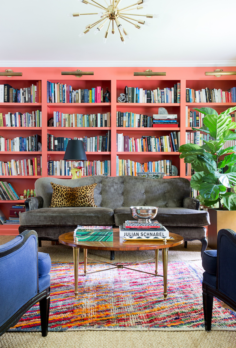 Coral bookshelves in living room with grey couch