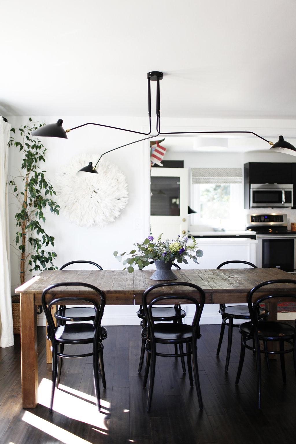 Dark bentwood chairs via RUE
