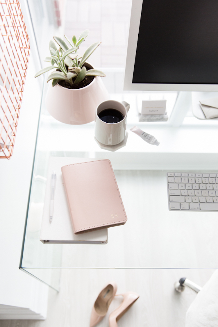 Desk with pink notebook