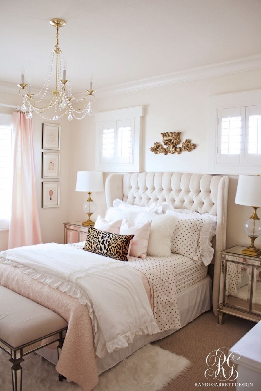 Feminine bedroom with white tufted headboard by Randi Garrett