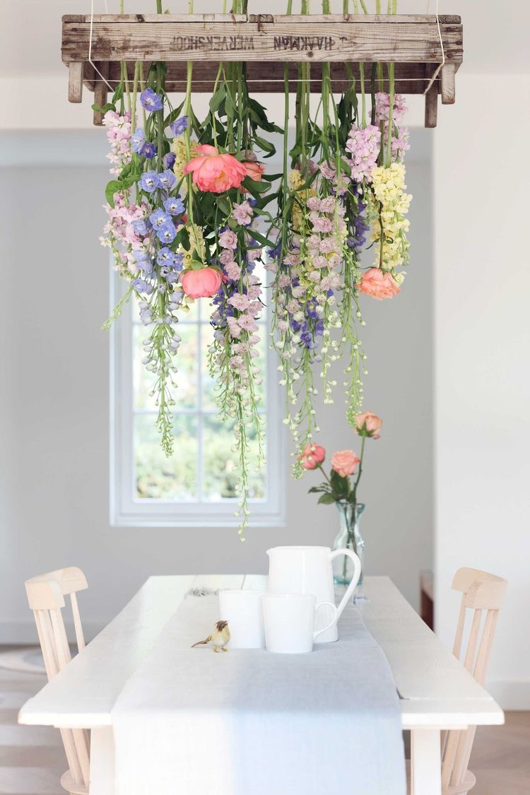 Flower box hanging garden upside down above dining table