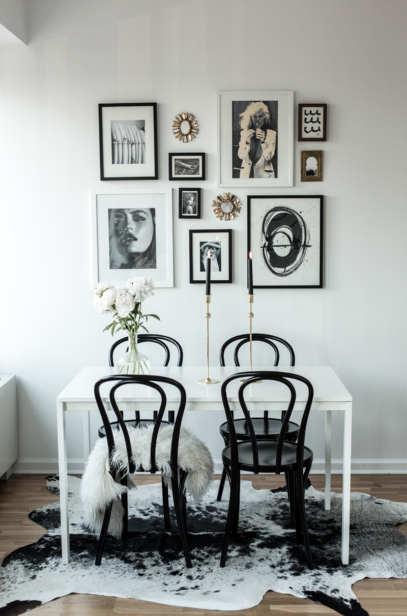 Gallery wall with black bentwood chairs in dining room