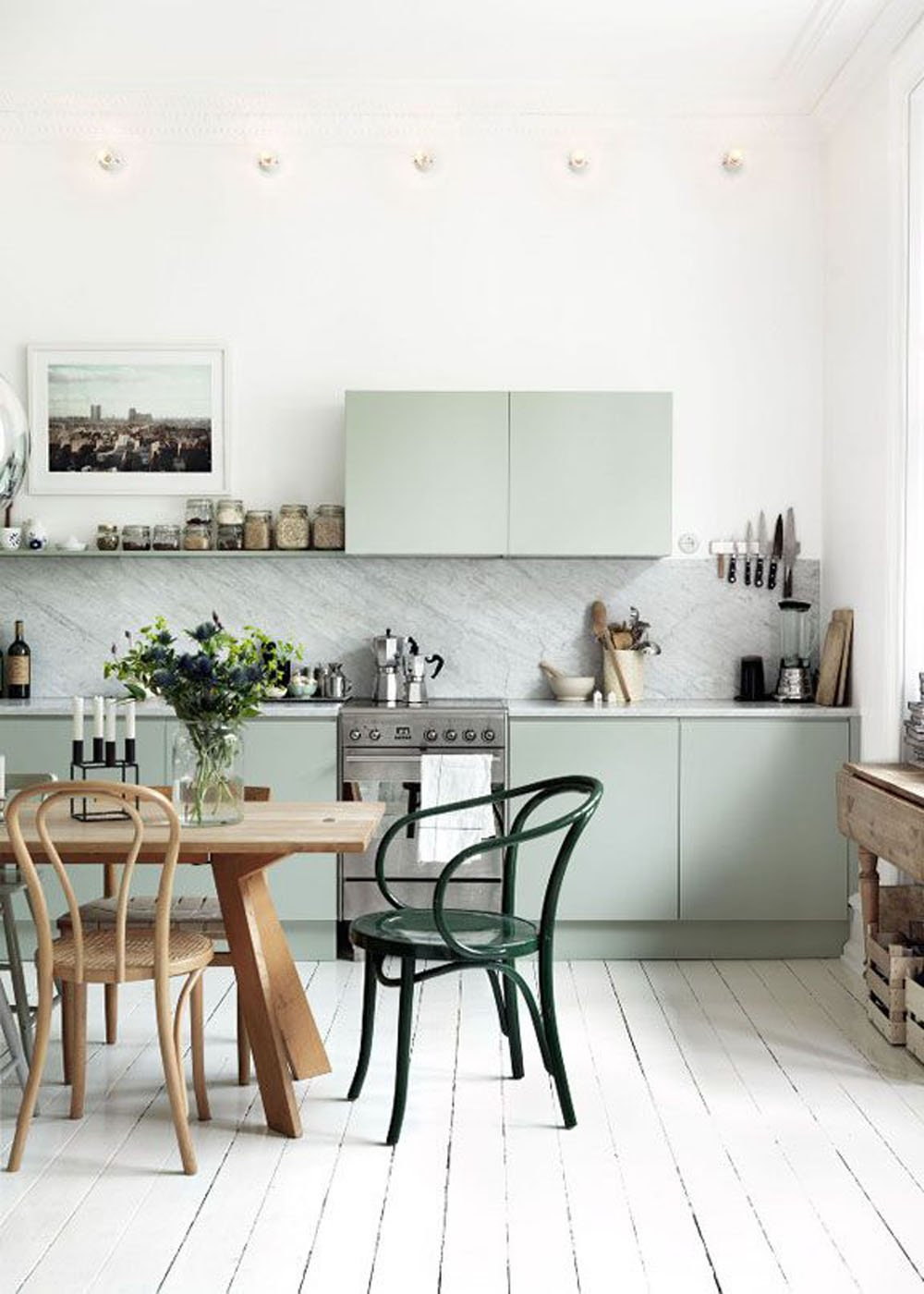 Green bentwood chairs in the kitchen via Petra Bindel