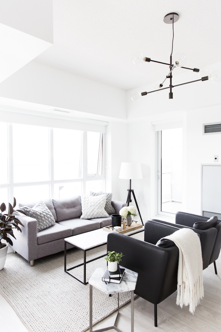 Grey sofa with two black sitting chairs