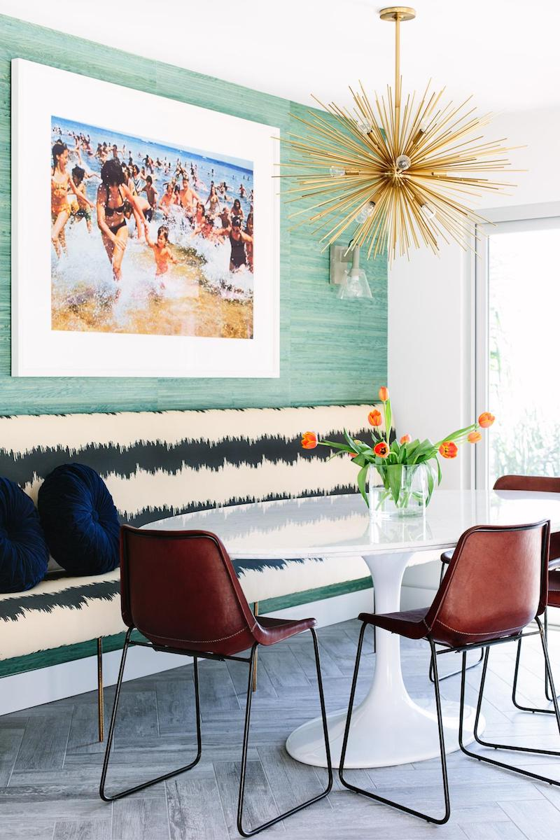 Hollywood dining room with starburst chandelier via Caitlin Murray