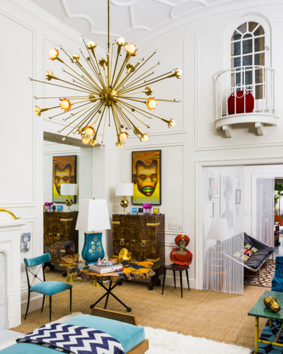 Jonathan Adler living room with gold starburst chandelier