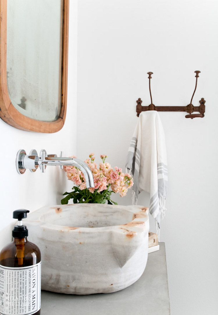 Marble vessel sink with silver faucet