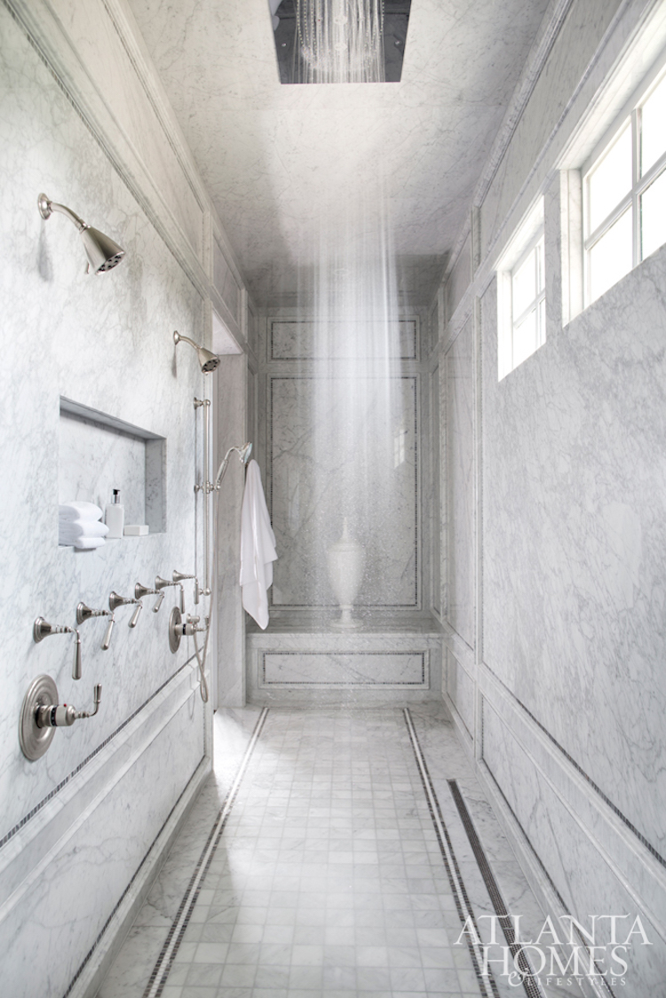 Marble walk-in shower with dark silver fixtures