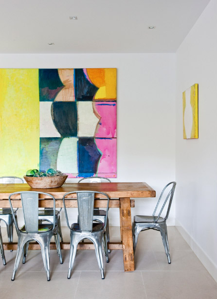 Metal tolix chairs with bright abstract art
