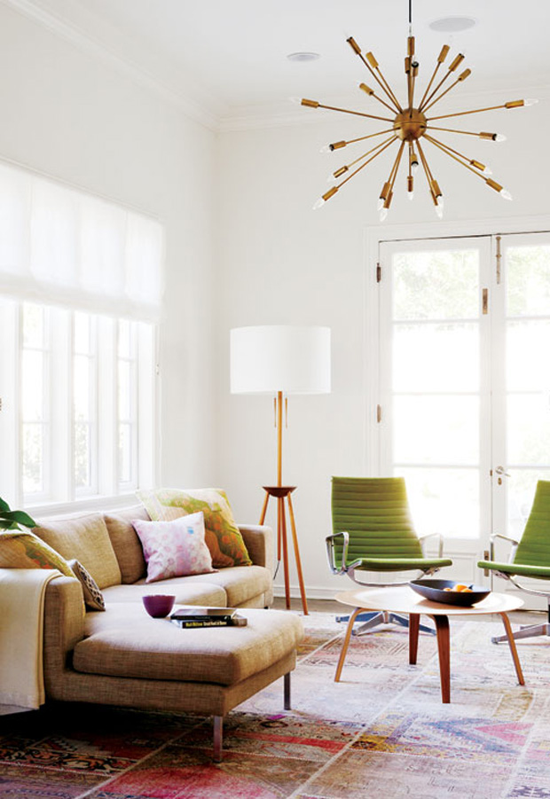 Midcentury-modern living room with sputnik chandelier via Style At Home