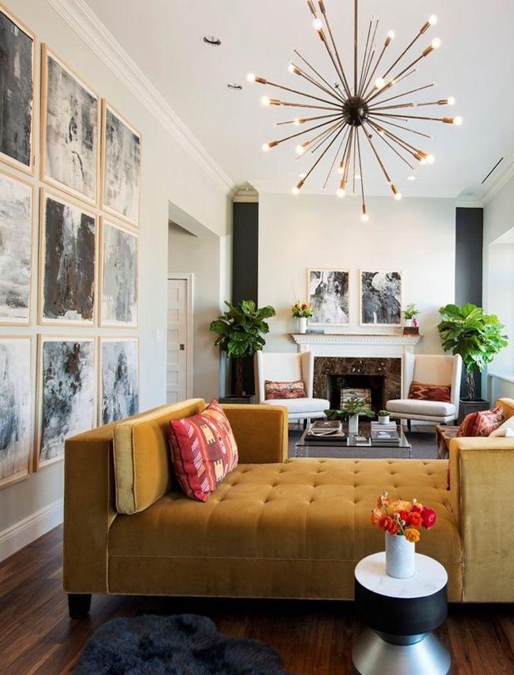 Mustard couch with starburst chandelier via Richard Caplan