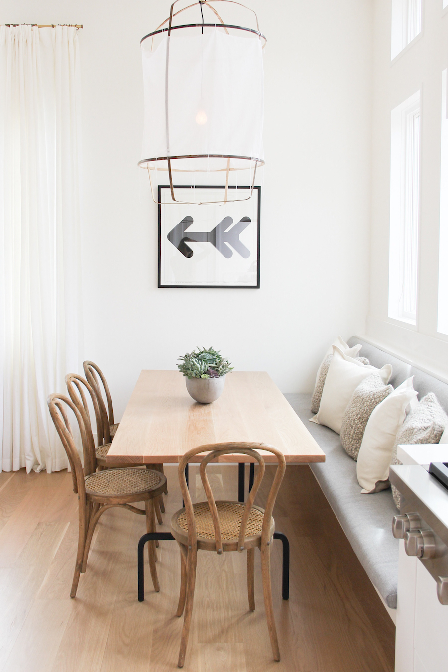 Natural wood bentwood chairs with banquette via 30collins