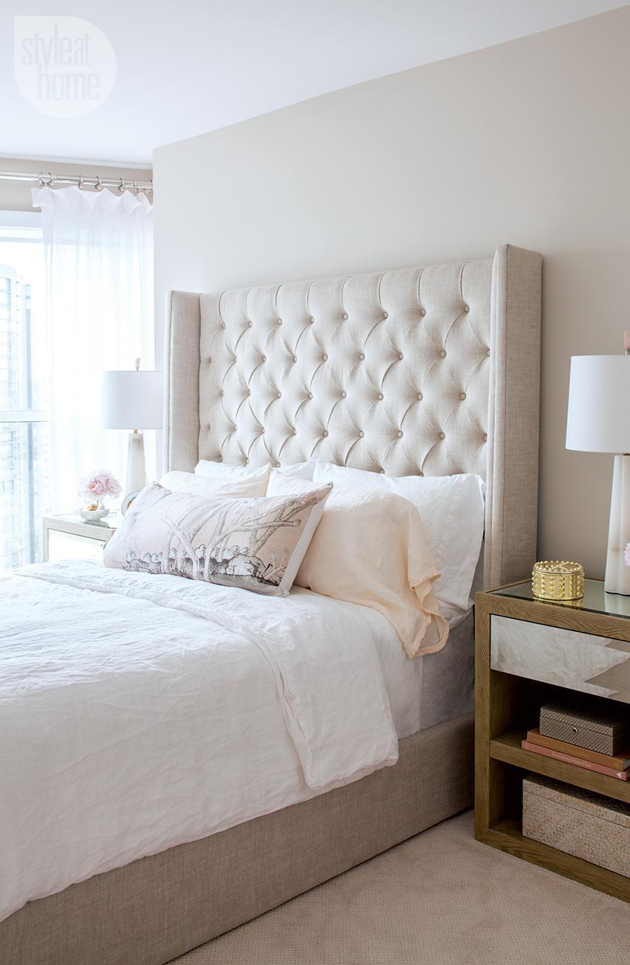 Neutral tufted wingback headboard bedroom