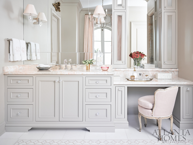 Pale pink countertop in feminine bathroom