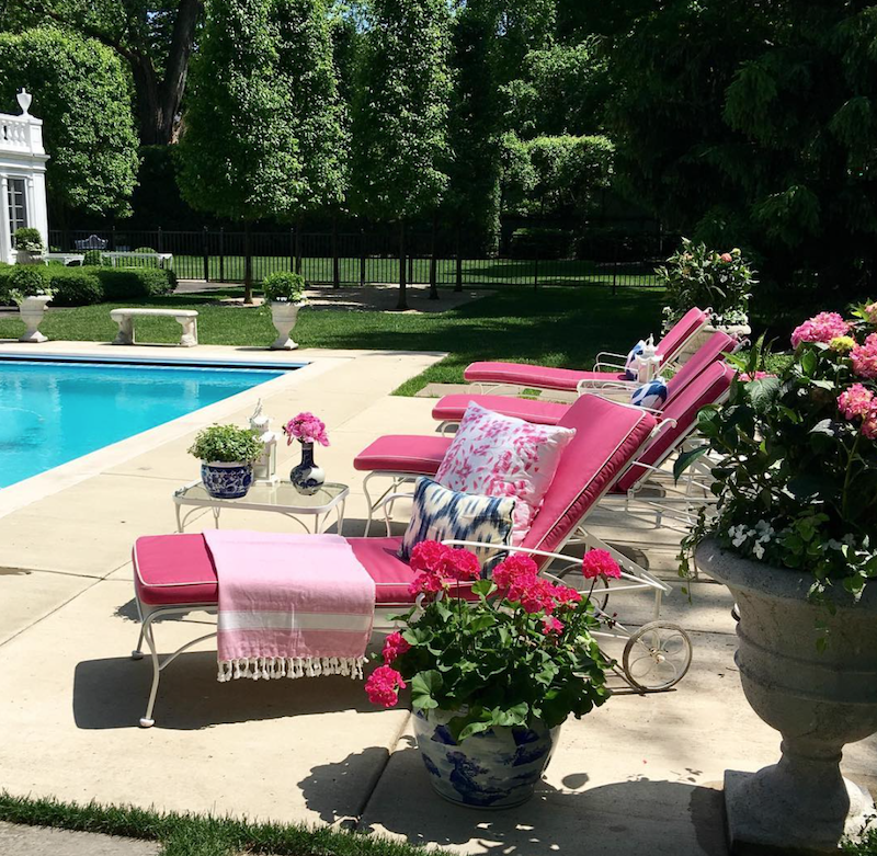 Pink outdoor chaise lounges via Shelley Johnstone Design