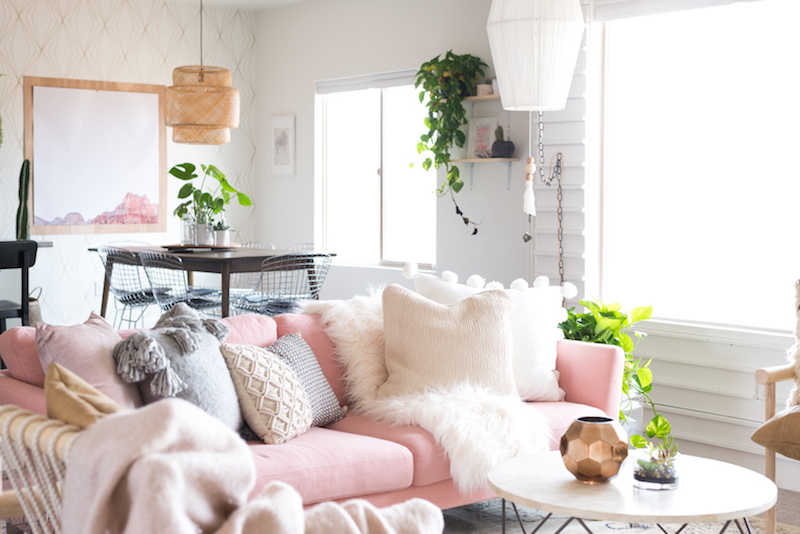 Pink sofa with white fur throw