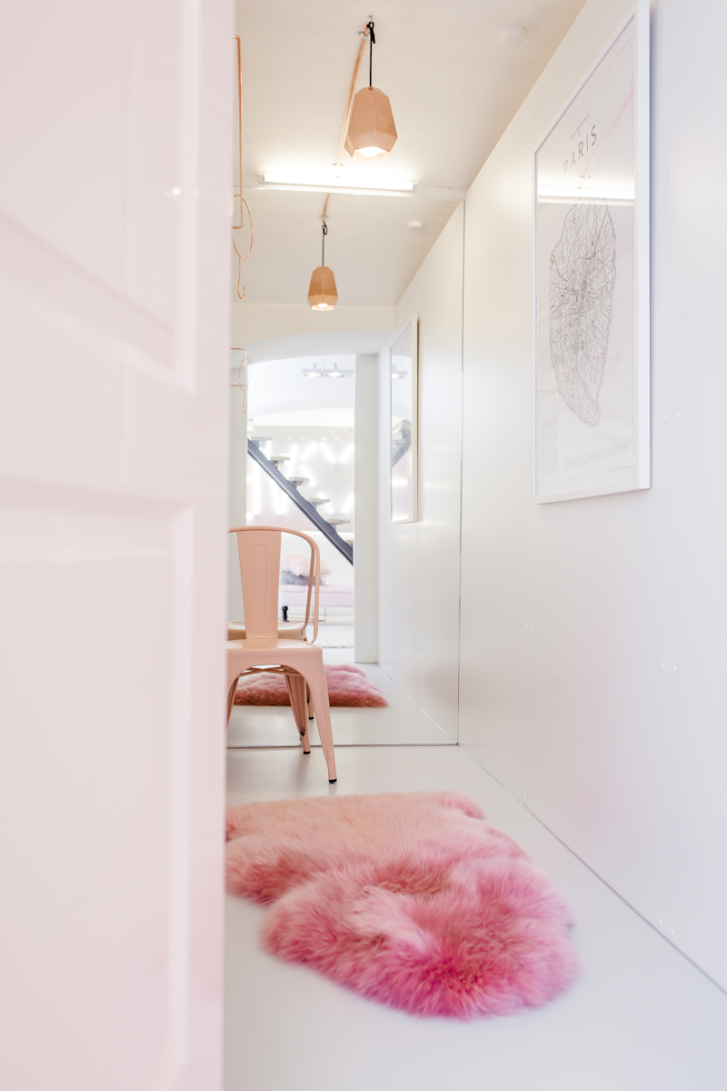 Pink Tolix chair with pink sheepskin rug