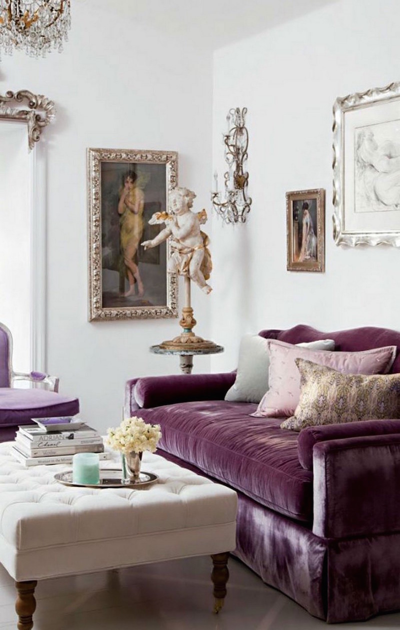 Purple velvet couch with angel sculpture via AD