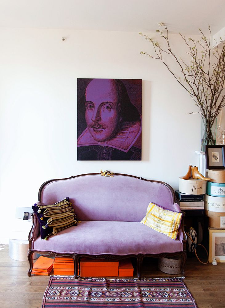 Purple velvet french sofa with Shakespeare art via The Selby