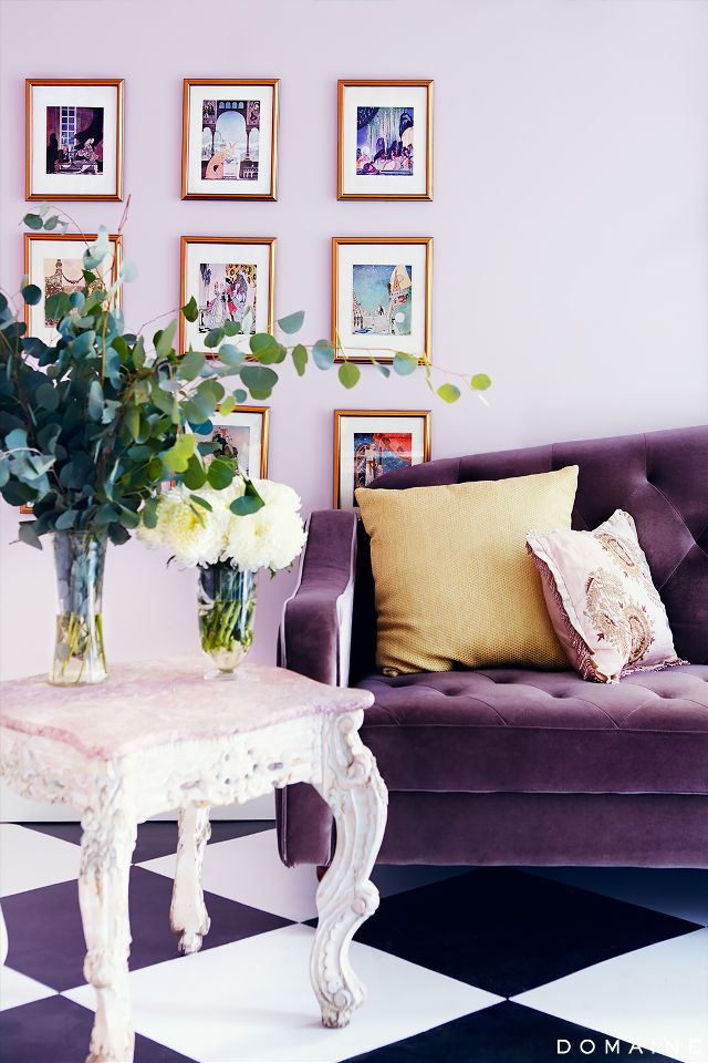 Purple velvet sofa with vintage white table