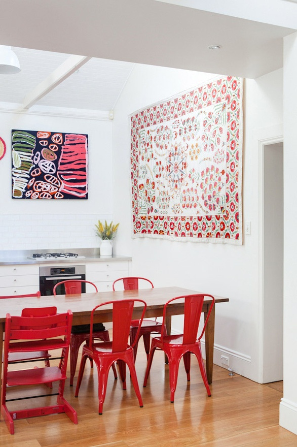 Red Tolix chairs and Oversized Art via Design Files