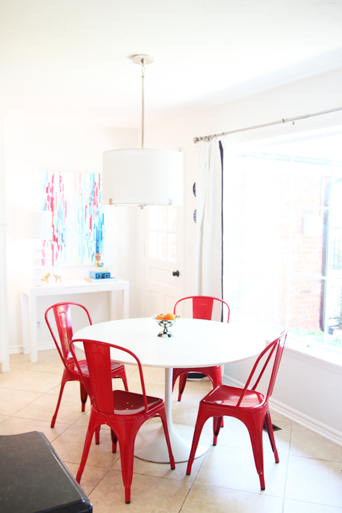 Red tolix chairs in breakfast nook