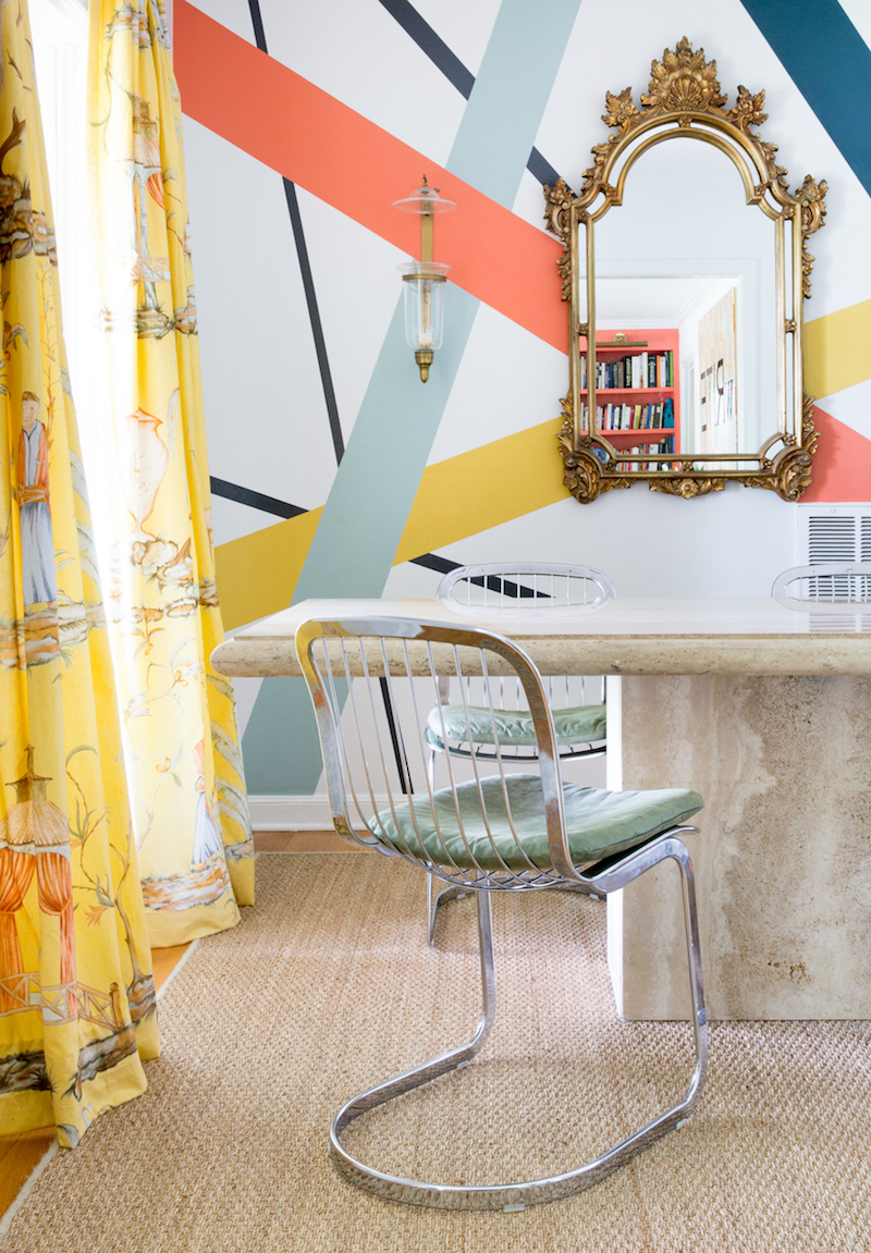 Silver dining chairs with multi-colored walls