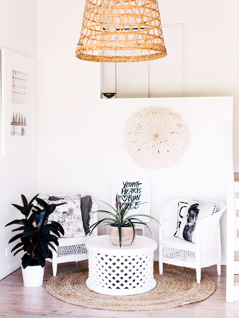 Sitting area with two white wicker chairs