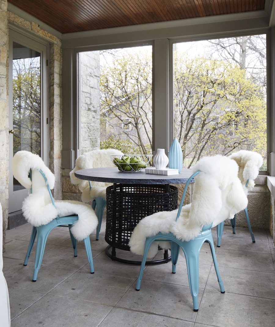 Soft blue tolix chairs with white sheepskin throws via Amy Kartheiser Design