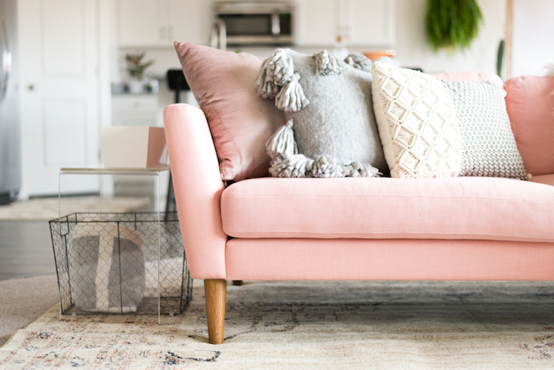 Soft pink sofa in living room