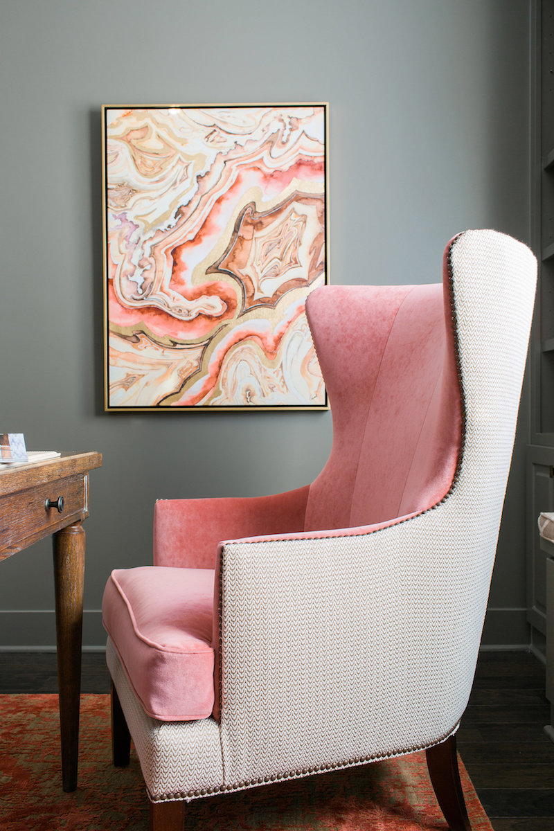 Soft pink wingback chair with marble artwork