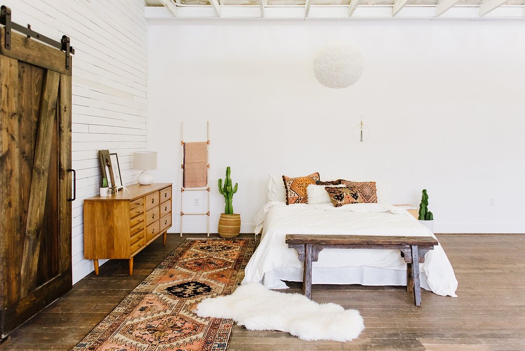 Southwestern bedroom with rug by Loom + Kiln