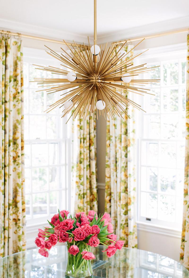 Sputnik chandelier with pink flowers via Anna Matthews Interiors