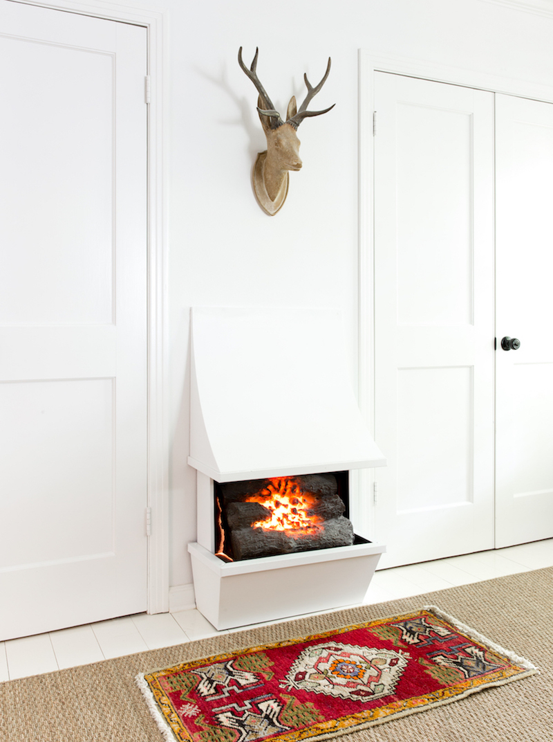 Standalone fireplace against wall
