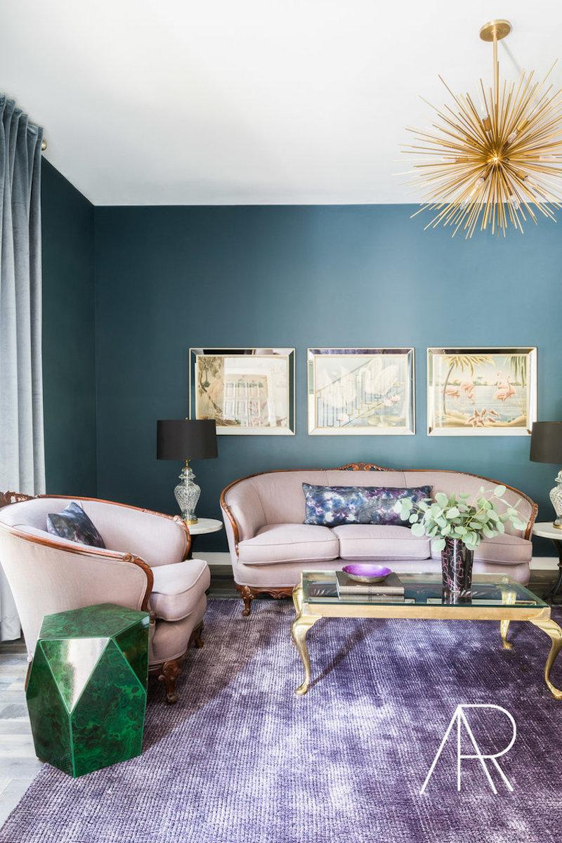 Starburst Chandelier in Teal Wall Living Room with purple rug via Alyssa Rosenheck MyDomaine