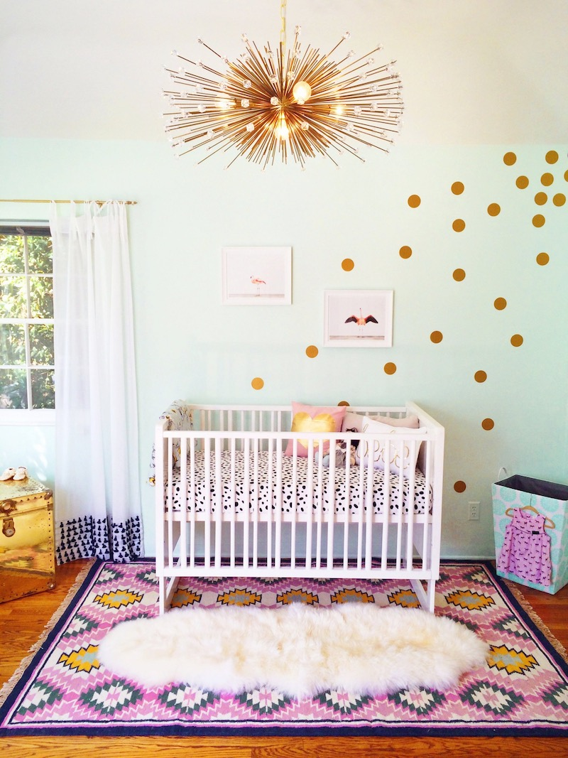 Starburst chandelier inside girl's nursery via Rachelle Wood Apt Therapy