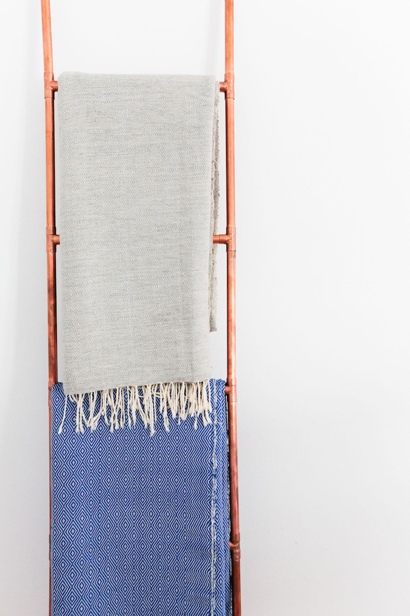 Textile throws hanging on ladder