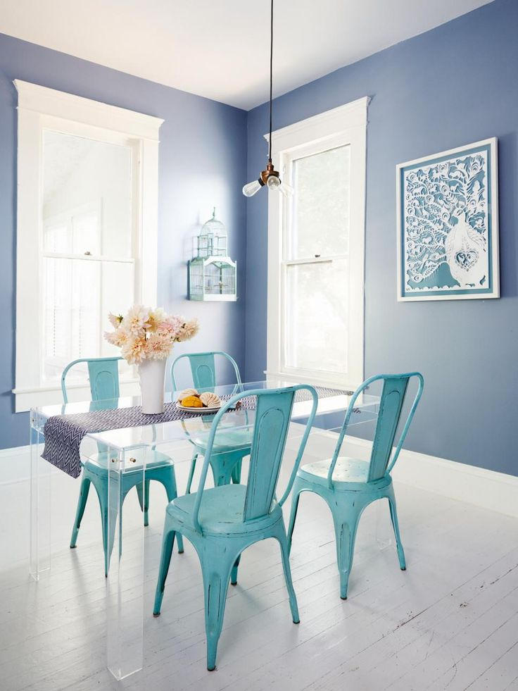 Turquoise tolix chairs in dining room