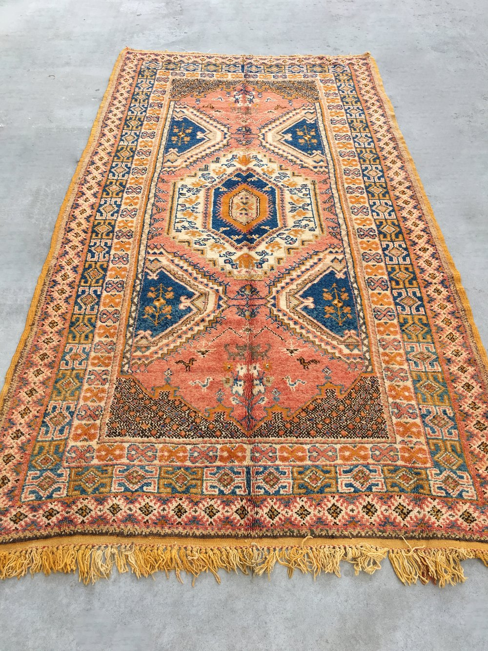 Vintage orange oriental rug from Loom + Kiln