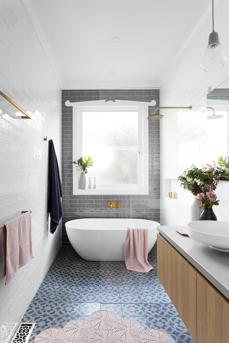 Gray Subway Tiling in a Serene Pink & White Bathroom